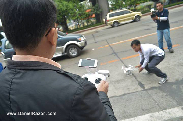 uya Daniel Razon preps one of UNTV's news-and-rescue drones for its test flight. The drone is controlled by a remote device with a viewing panel for viewing through its camera.
