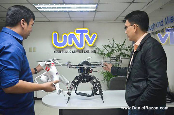 Kuya Daniel Razon (right) and UNTV Reporter Mon Jocson (left) looking at the UNTV drones to be used in the network's news and rescue operations.