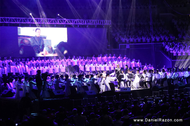 "Kuya Daniel Razon sings UNTV's then theme song which chorus speaks about the very goal of the station: ""We are here gathered for a reason. To serve our God, people, and the nation."" (Photo courtesy of Photoville International)"
